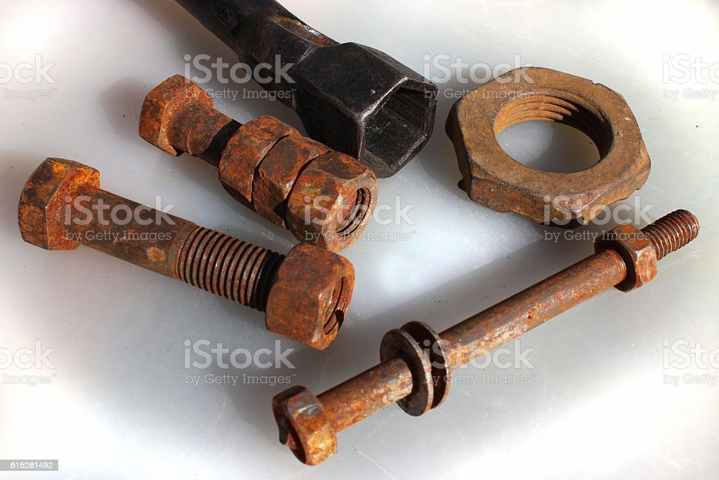 Old rusty bolts nuts and socket wrench stock photo