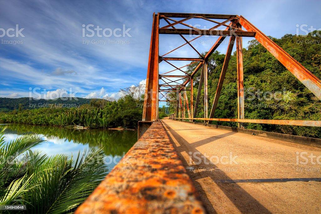 Old rusty bridge in countryside stock photo