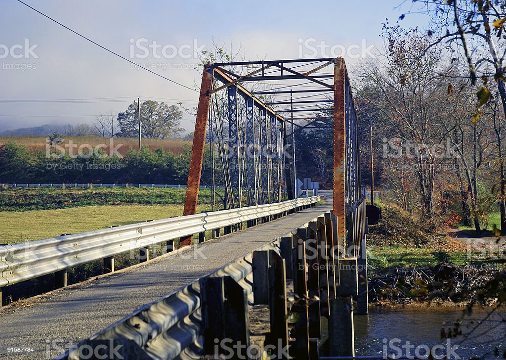 Old Rusty Bridge Over a River royalty-free stock photo