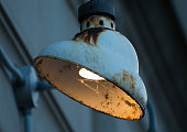 Old rusty building lamp