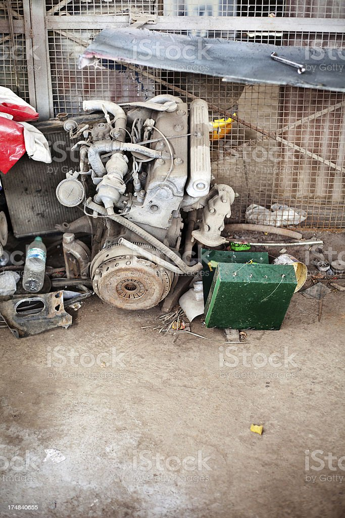 Old Rusty Car Engine lying in a Garage royalty-free stock photo