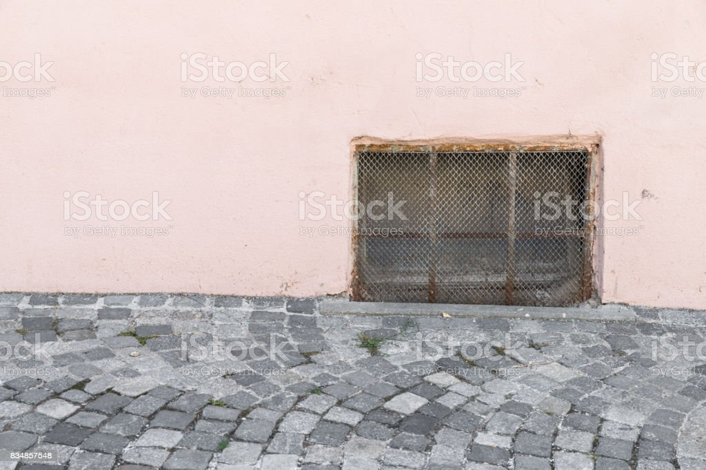 Old rusty Cellar window with iron grating stock photo