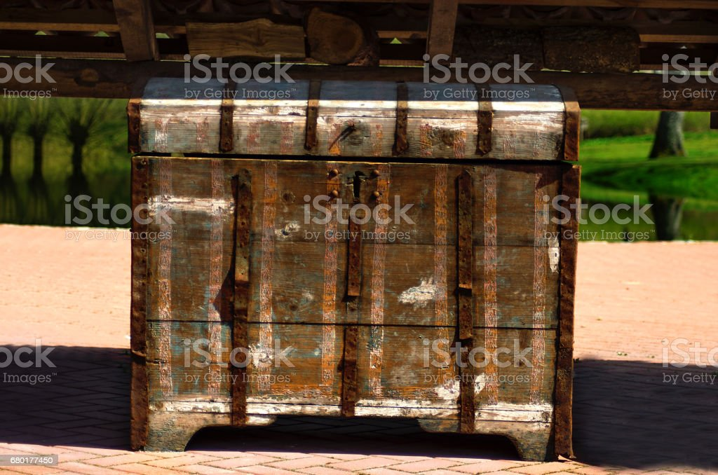 Old rusty chest standing in garden stock photo