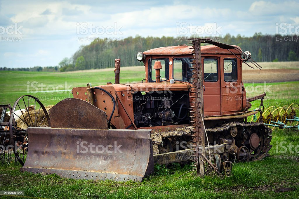 Old rusty crawler tractor with shovel stock photo