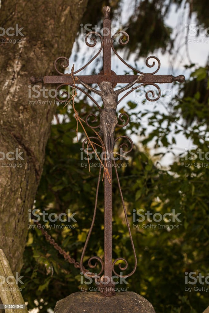 old rusty crucifix with Jesus Christ stock photo