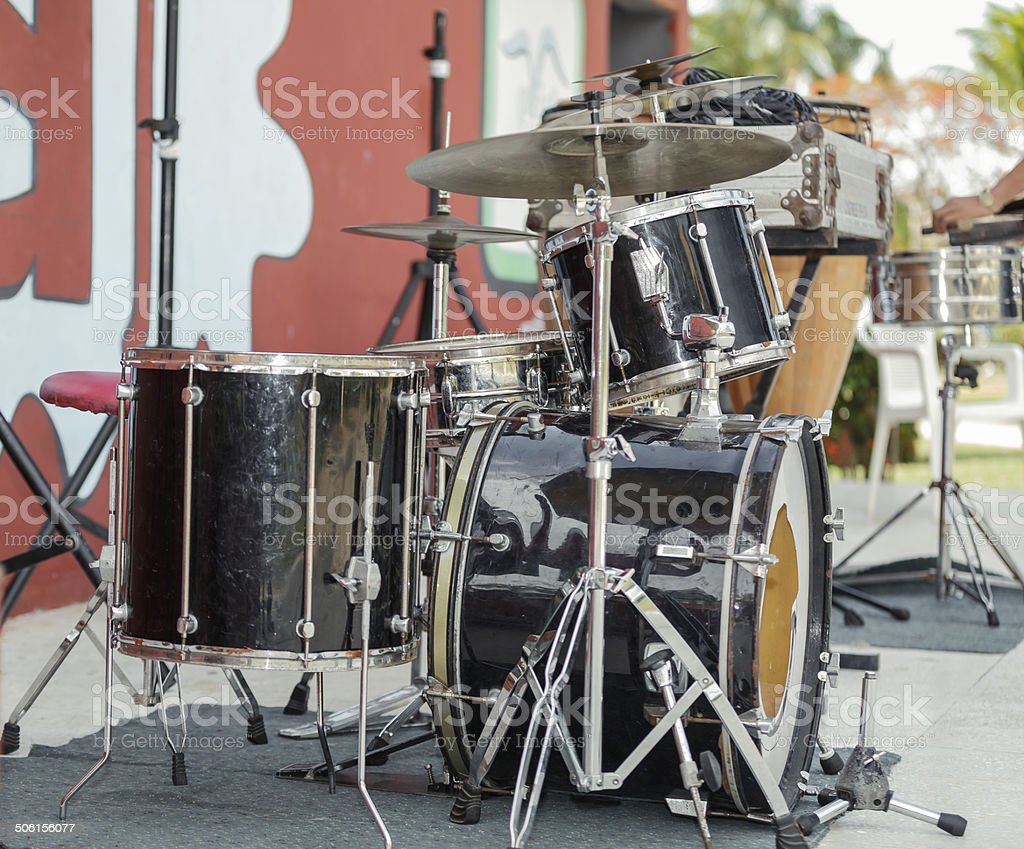 Old rusty dirty drum kit on outdoor concert stage stock photo