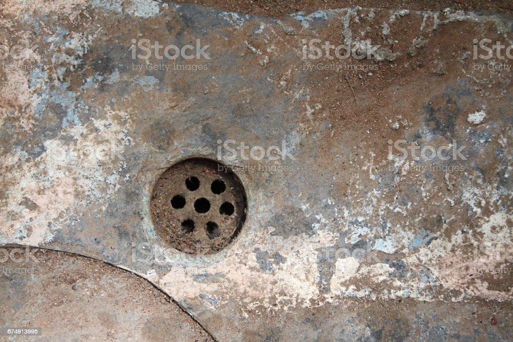 Old rusty drain hole stock photo