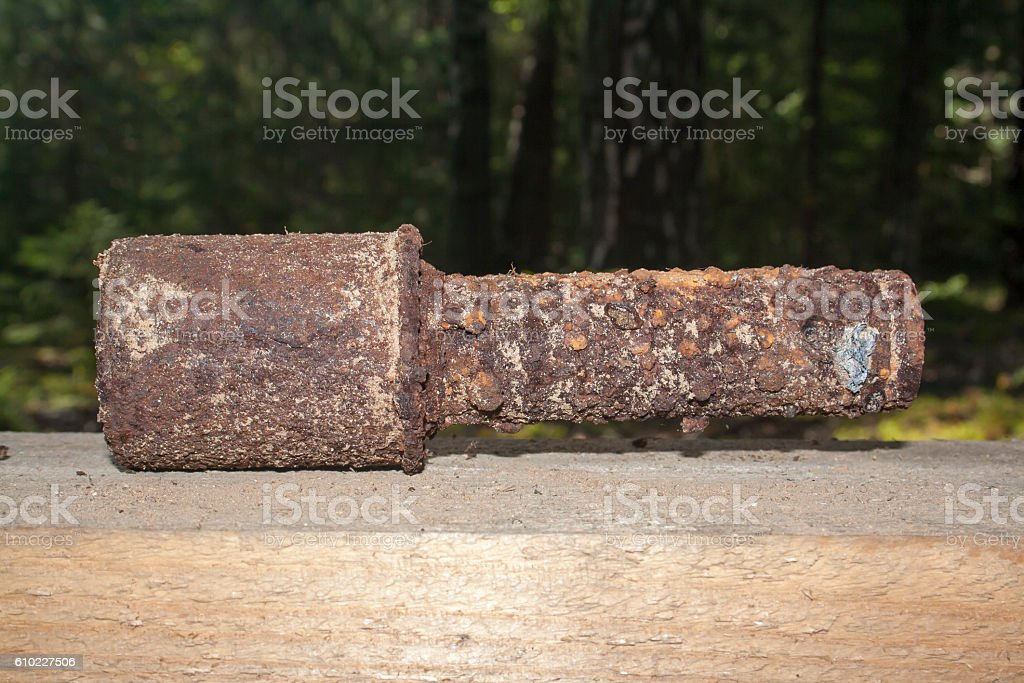 old rusty grenade stock photo