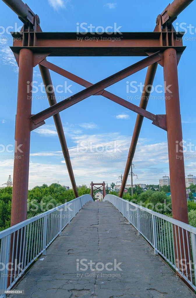 Old rusty iron footbridge stock photo