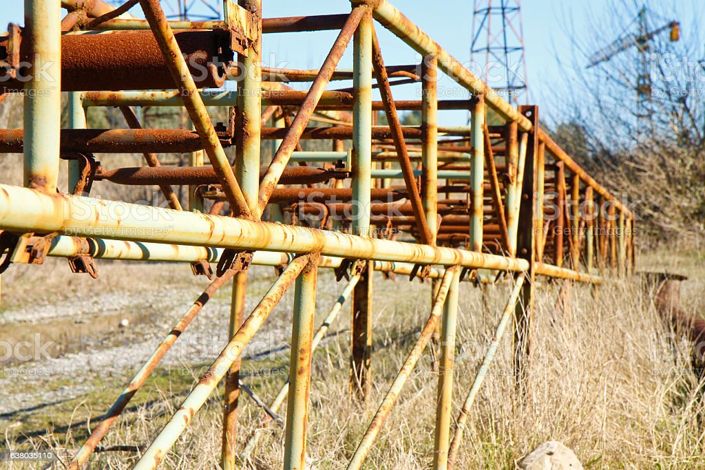 Old rusty iron reticular structure with metal tubular profiles stock photo