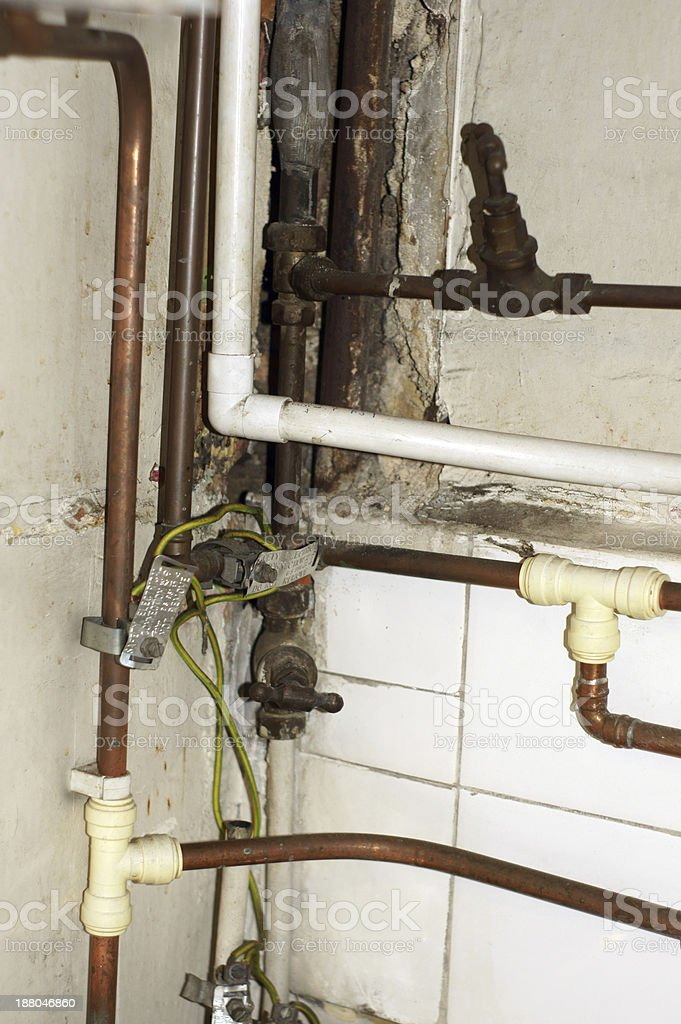 Old rusty kitchen pipes royalty-free stock photo