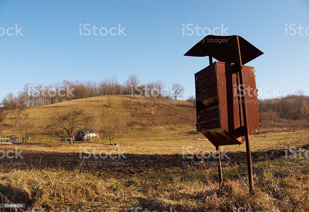 Old rusty mailbox in countryside stock photo