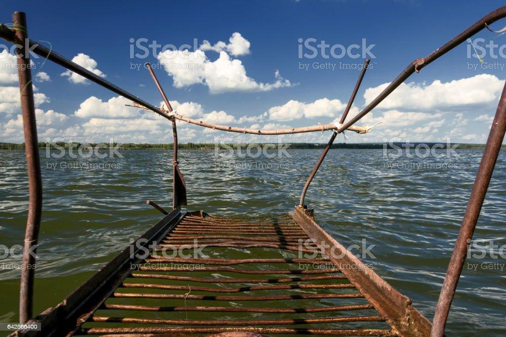 Old rusty metal bridges on the lake. stock photo