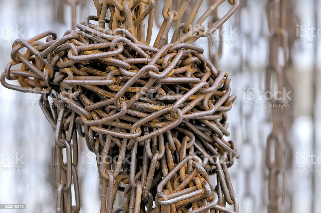 Old rusty metal chains are tied in knot stock photo