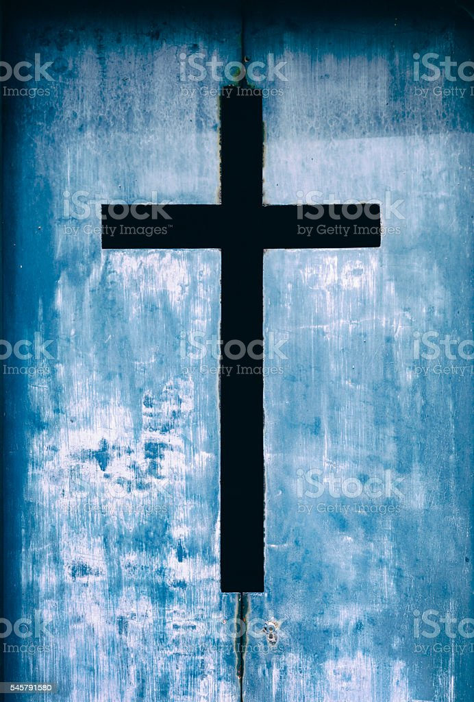 Old rusty metal cross stock photo