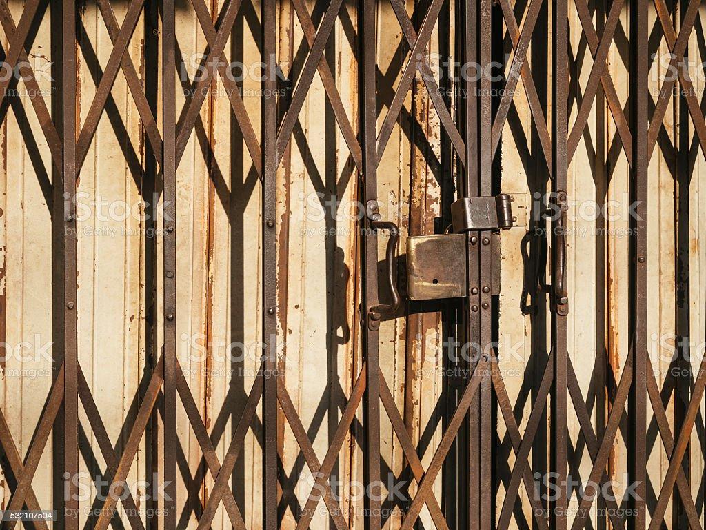 Old Rusty Metal Door Shutter Cross Pattern stock photo