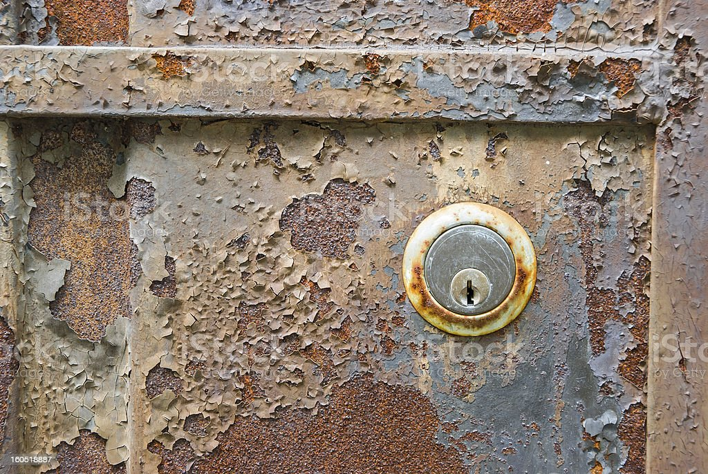 Old rusty metal plate and lock heavily corroded royalty-free stock photo