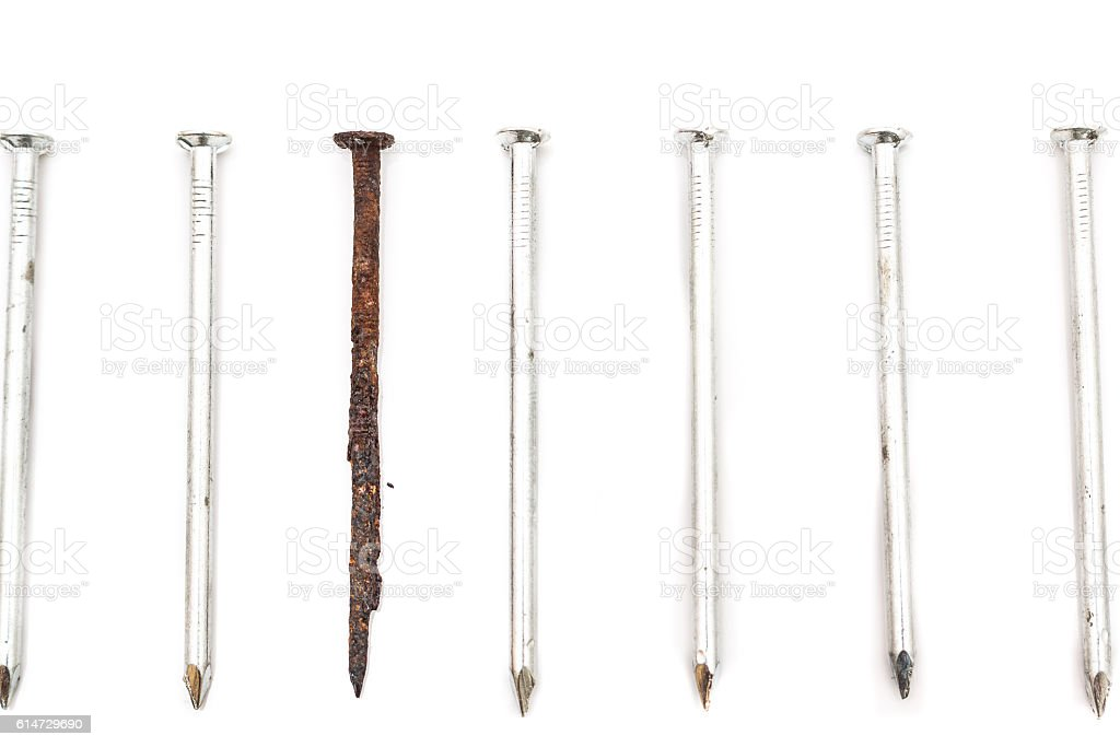 Old rusty nail and new ones stock photo