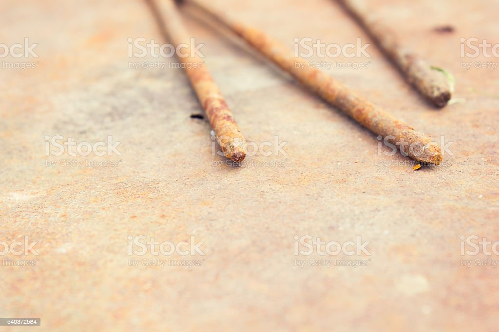 Old rusty nails are on gland stock photo