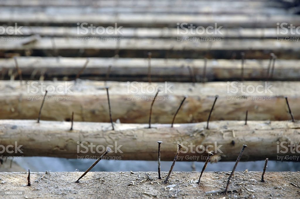 old rusty nails in purlins on roof stock photo