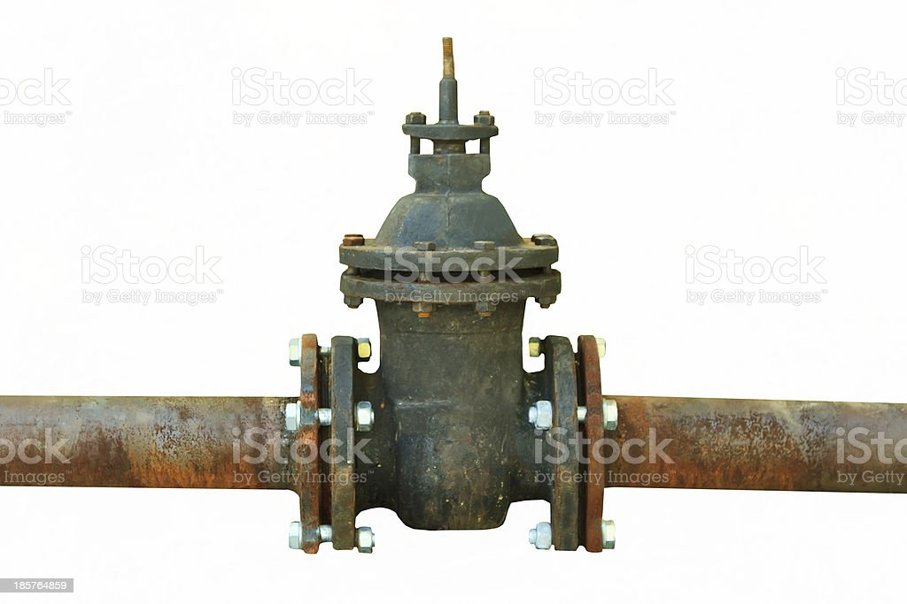 old rusty pipe with shut-off valve over green grass royalty-free stock photo
