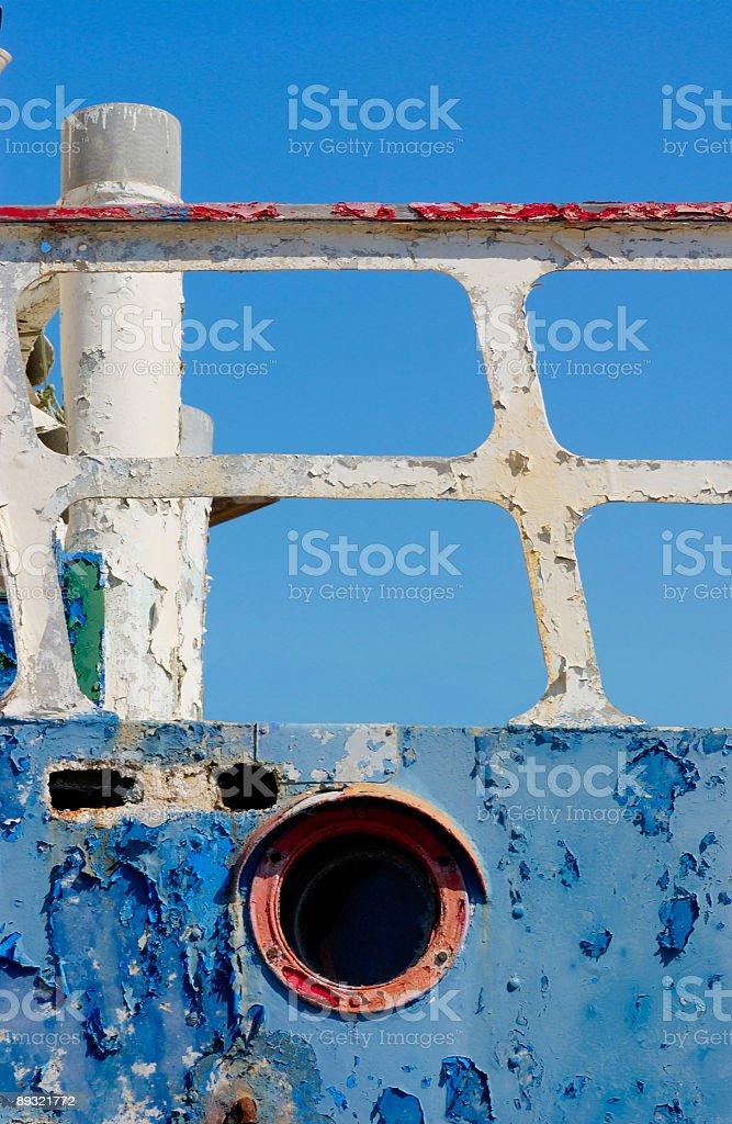 Old rusty porthole and rails royalty-free stock photo
