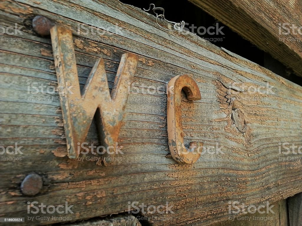 Old rusty rural wc stock photo