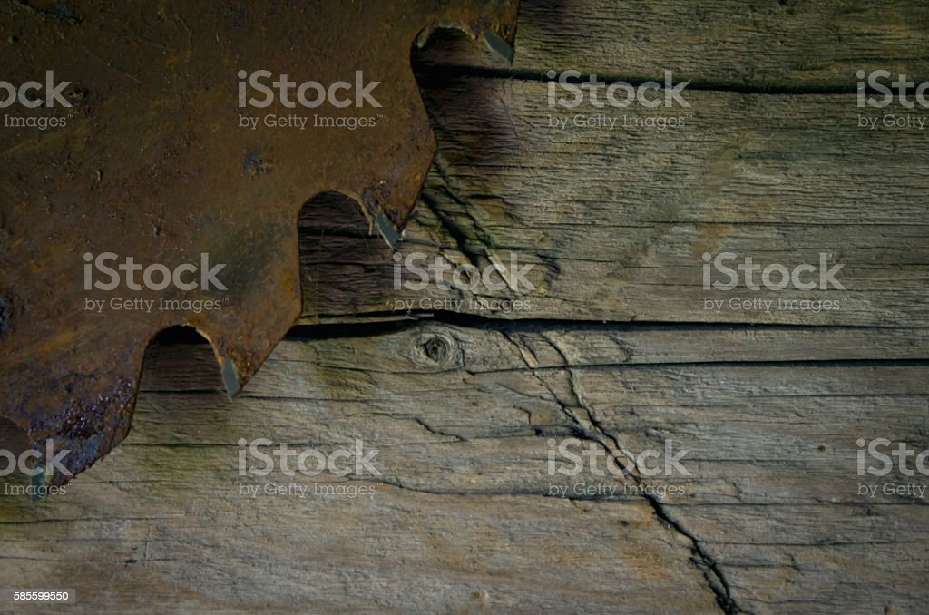 Old rusty saw on wooden surface stock photo