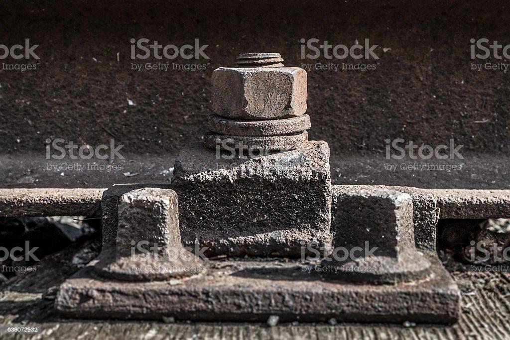 old rusty screw , iron bolts on railway stock photo