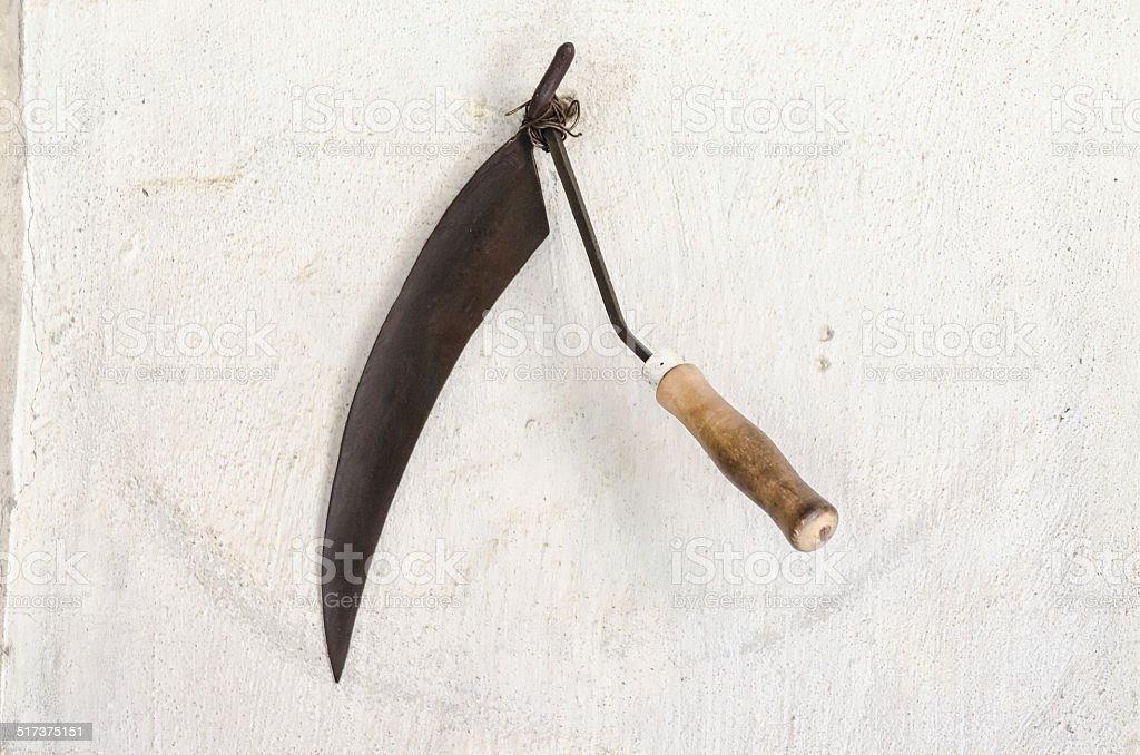 Old rusty sickle stock photo