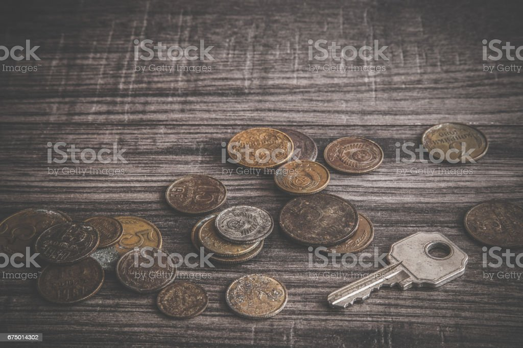 Old, rusty USSR money with old key on the wooden table. Retro, vintage style. stock photo