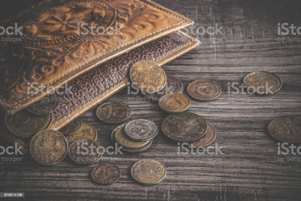 Old, rusty USSR money with old wallet on the wooden table. Retro, vintage style. stock photo