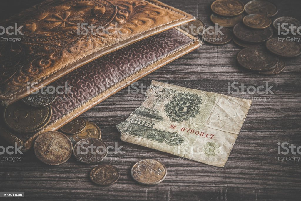 Old, rusty USSR money with old wallet on the wooden table. Torn money. Retro, vintage style. stock photo