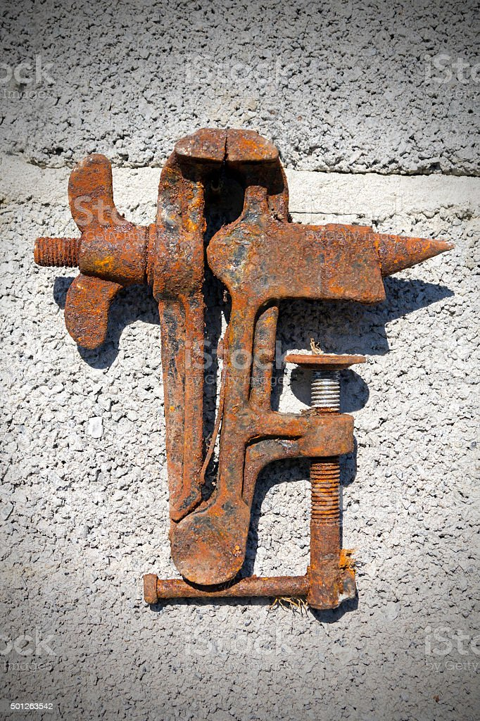 Old rusty vise on a fiery background stock photo