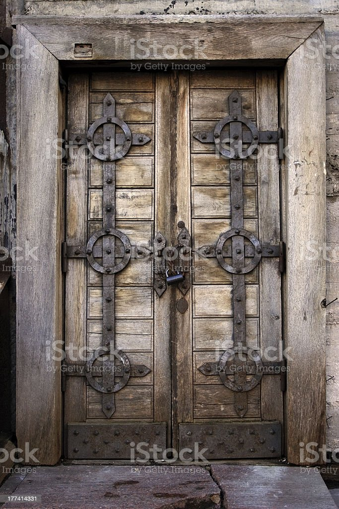 Old rusty wooden door royalty-free stock photo