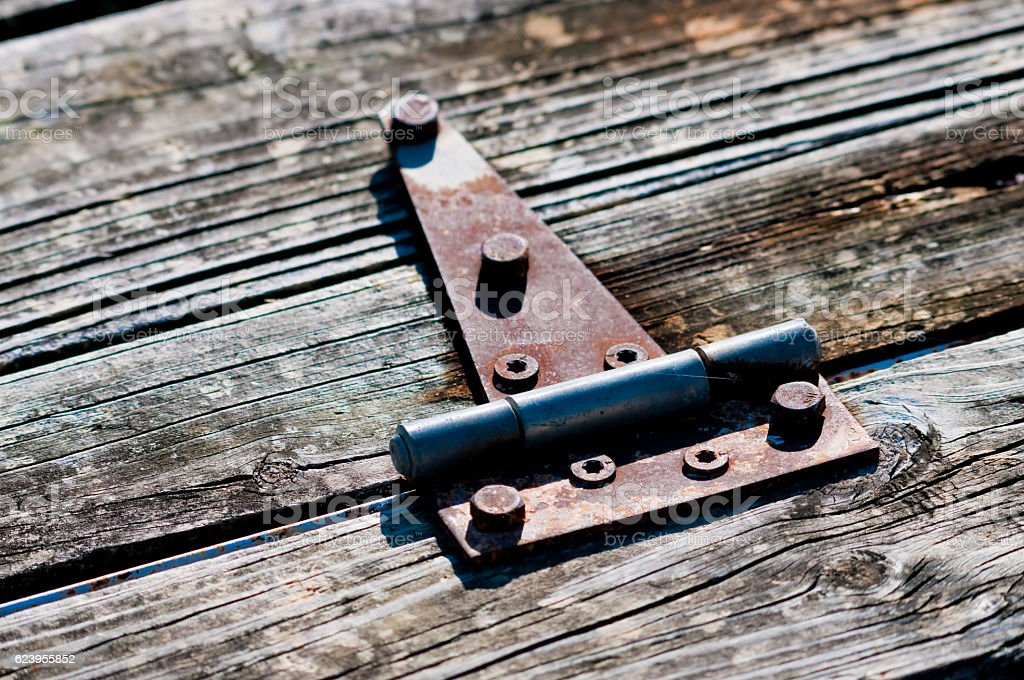 Old rusy hindge on wood stock photo