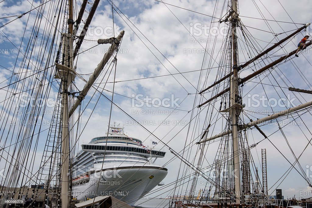 Old sailing ship and modern cruise liner stock photo