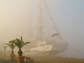 Old sailing ship in foggy day