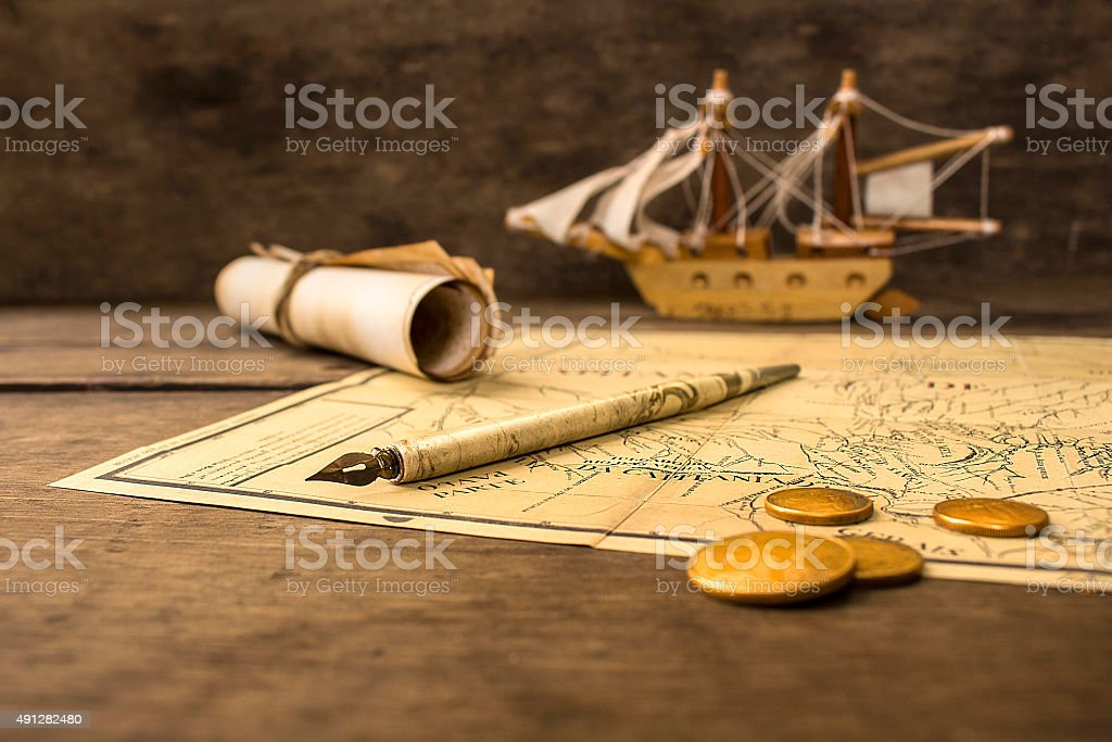 Old sailing ship model and objects over a captain´s cabin stock photo