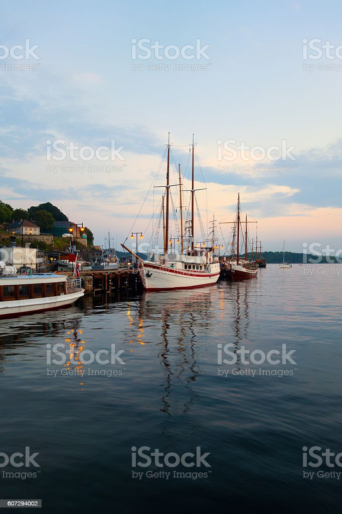 Old sailing ships at dusk, Oslo Harbour Norway stock photo