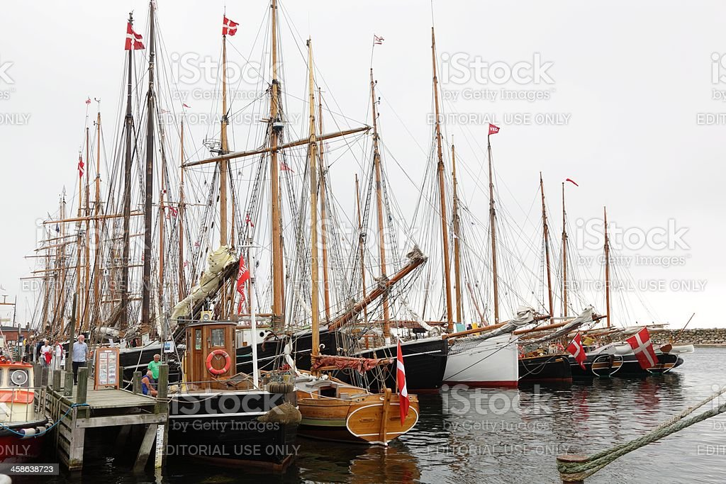 Old sailing ships in harbor stock photo