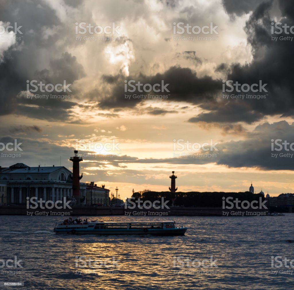 Old Saint Petersburg Stock Exchange and Rostral Columns at Neva river on sunset, Russia stock photo