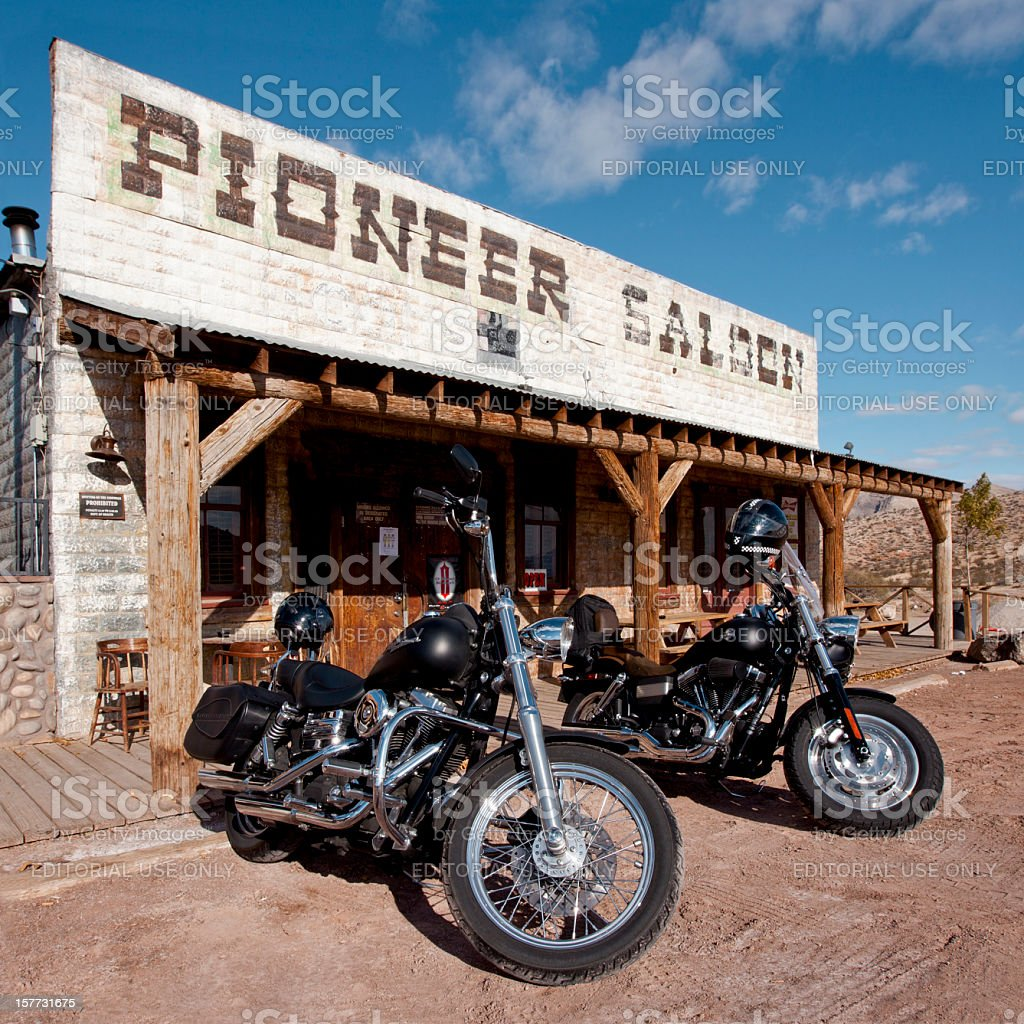 Old Saloon and new Harleys stock photo