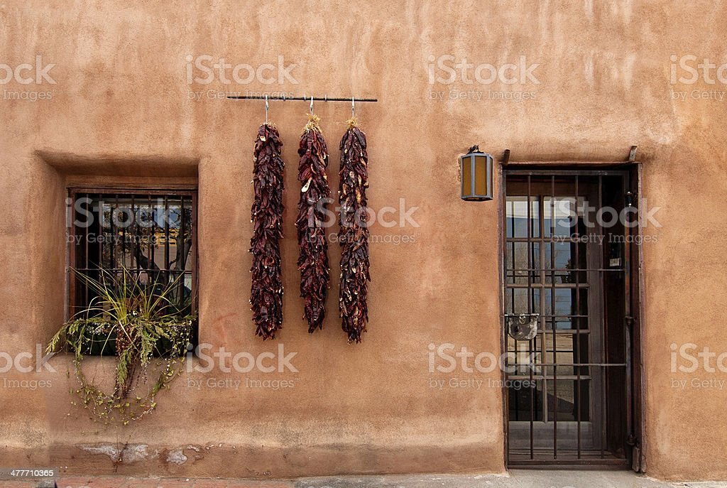 Old Santa Fe Style Adobe House and Chili Peppers royalty-free stock photo