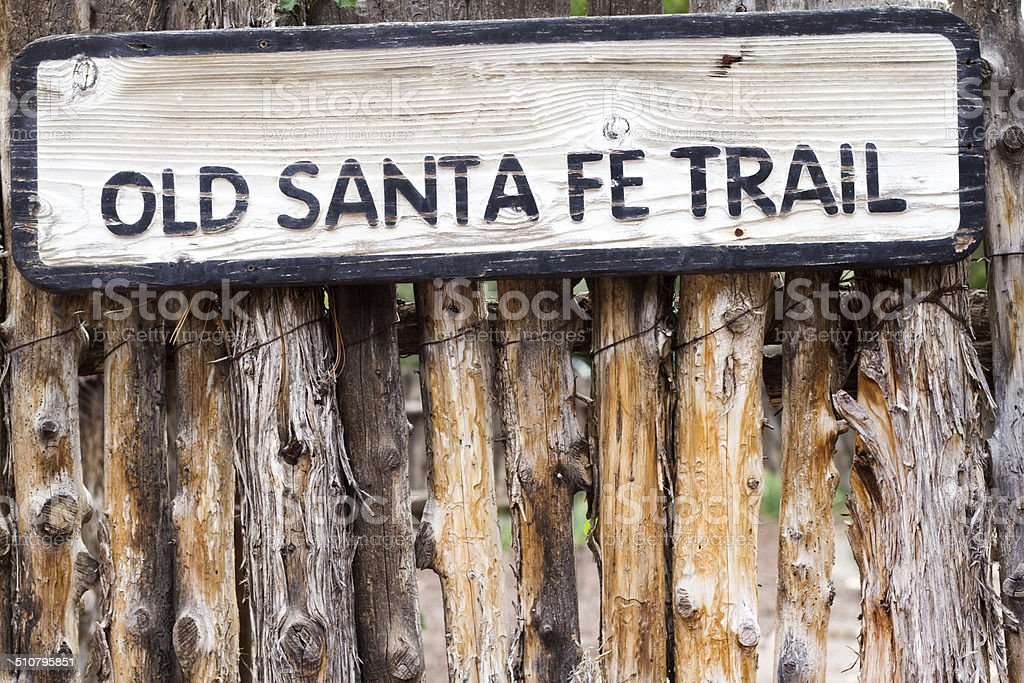 'Old Santa Fe Trail' Sign on Traditional Coyote Fence stock photo