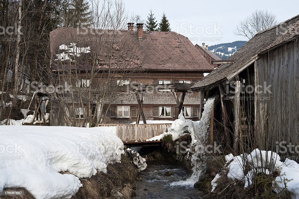 Old sawmill with water wheel stock photo