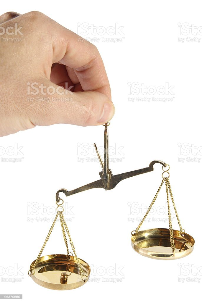 Old scales in a hand. (isolated) stock photo