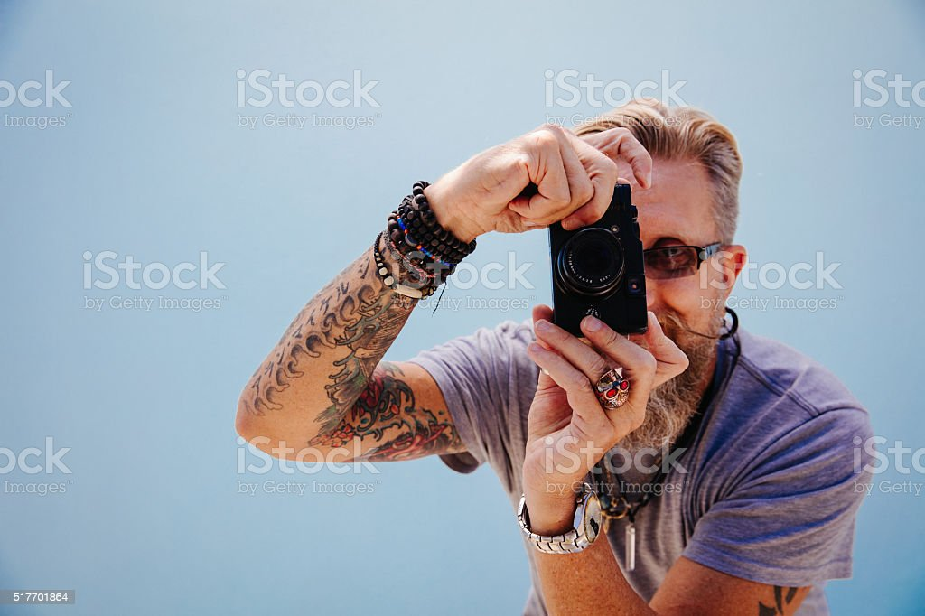 Old school photographer with scary skull ring stock photo