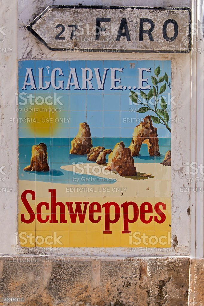 Old schweppes advertisement and directions sign to Faro stock photo