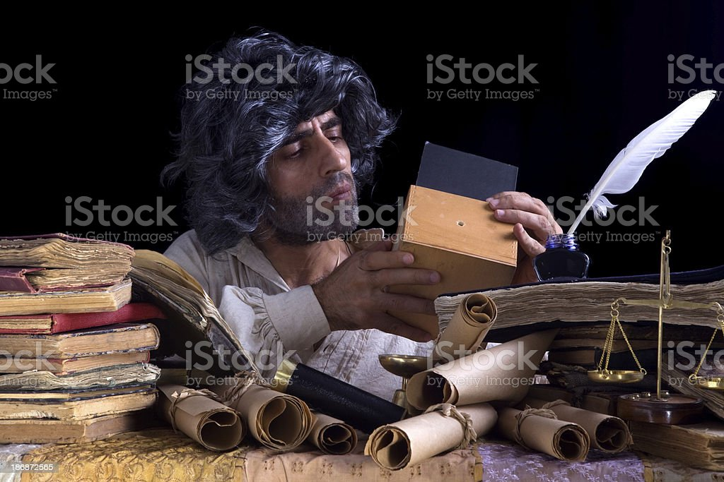 Old scientist inventor designing pinhole camera stock photo
